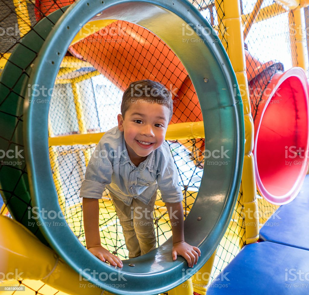 Happy boy playing at the playground stock photo
