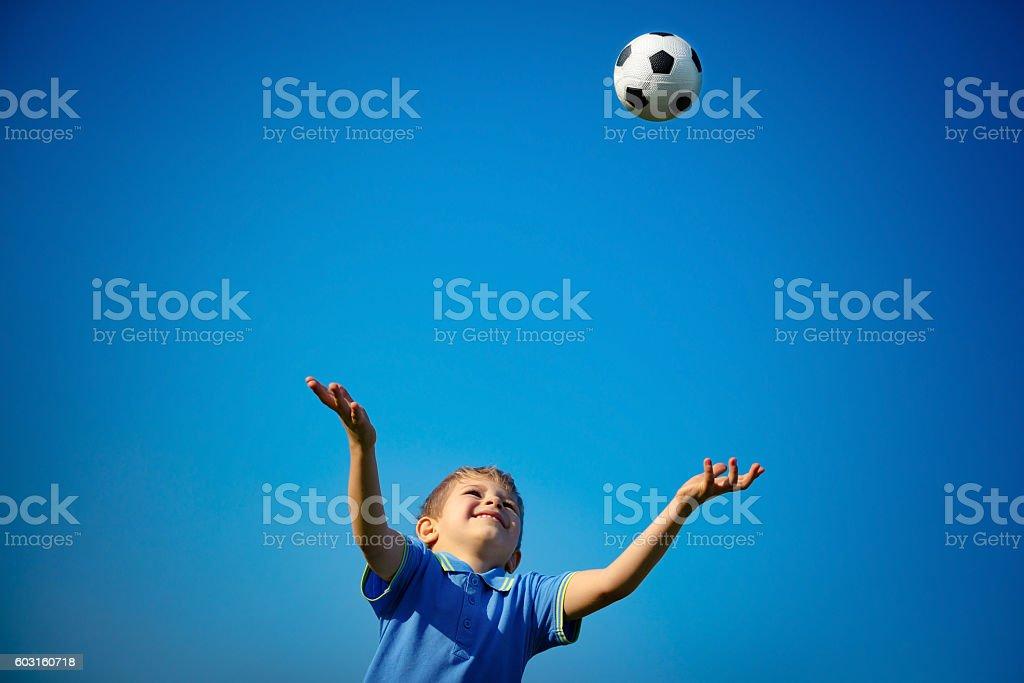 Happy boy playing ball stock photo