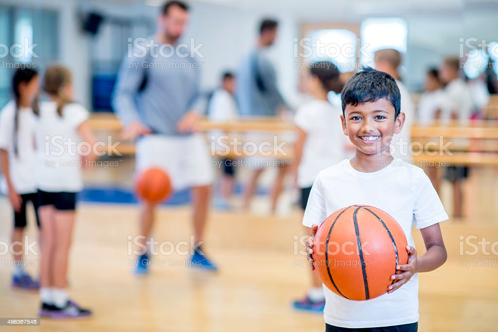 Happy Boy Playing Basketball stock photo