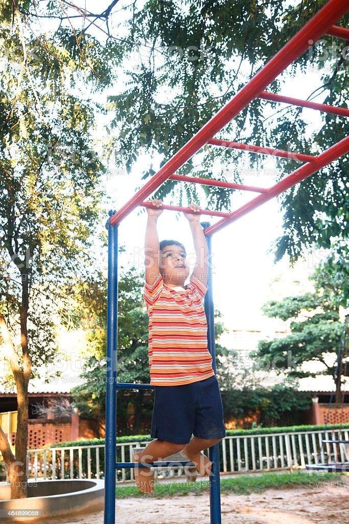 Happy boy playing playground . stock photo