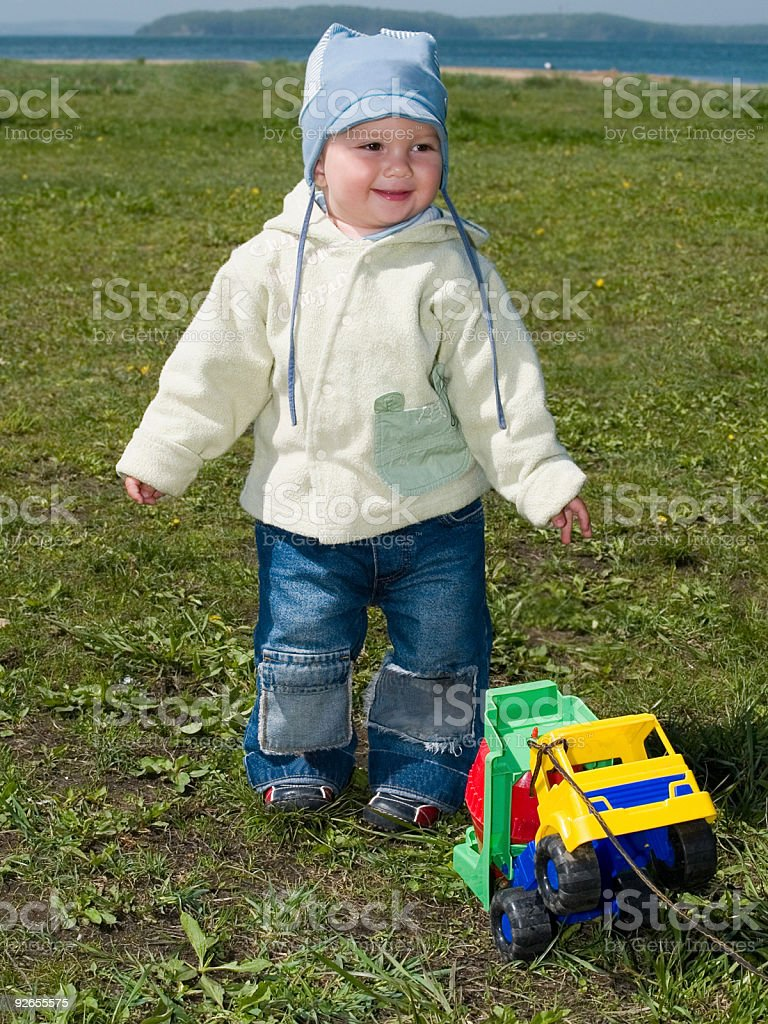 happy boy playing with car royalty-free stock photo