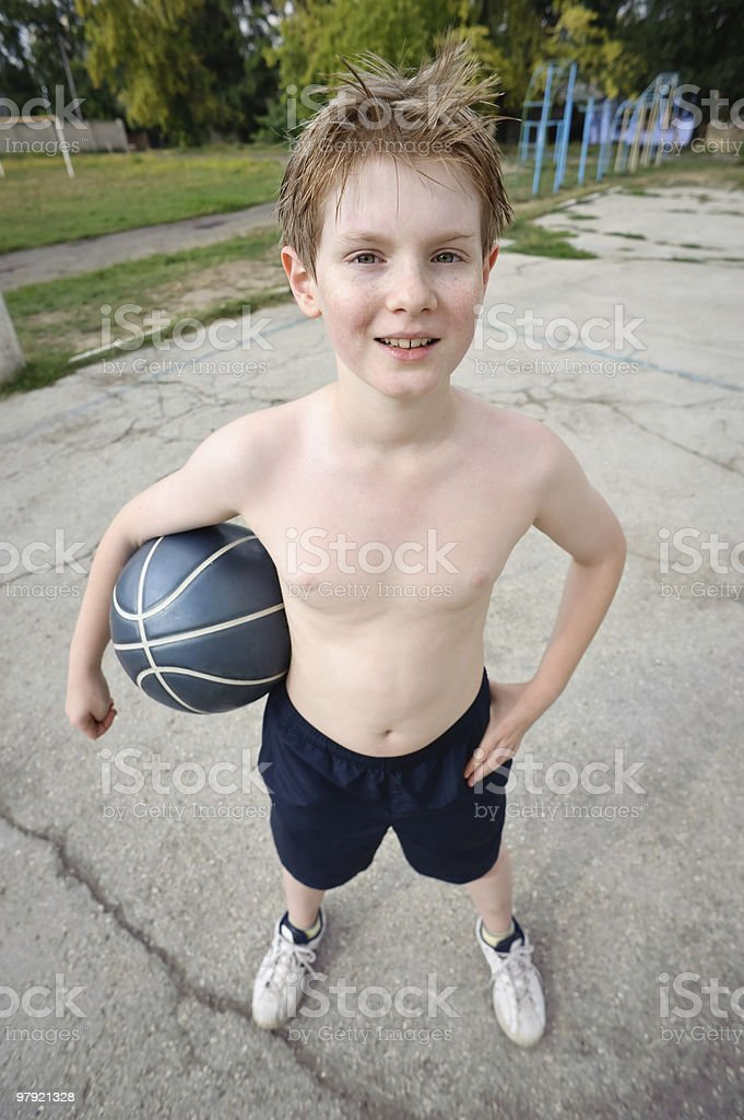 happy boy plays basketball royalty-free stock photo