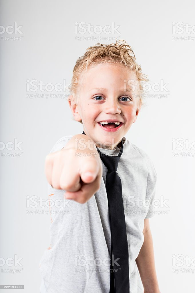 happy boy pointing out to you stock photo