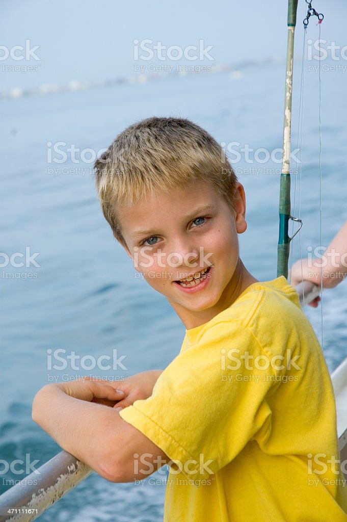 Happy Boy Riding On A Party Charter Fishing Boat stock photo