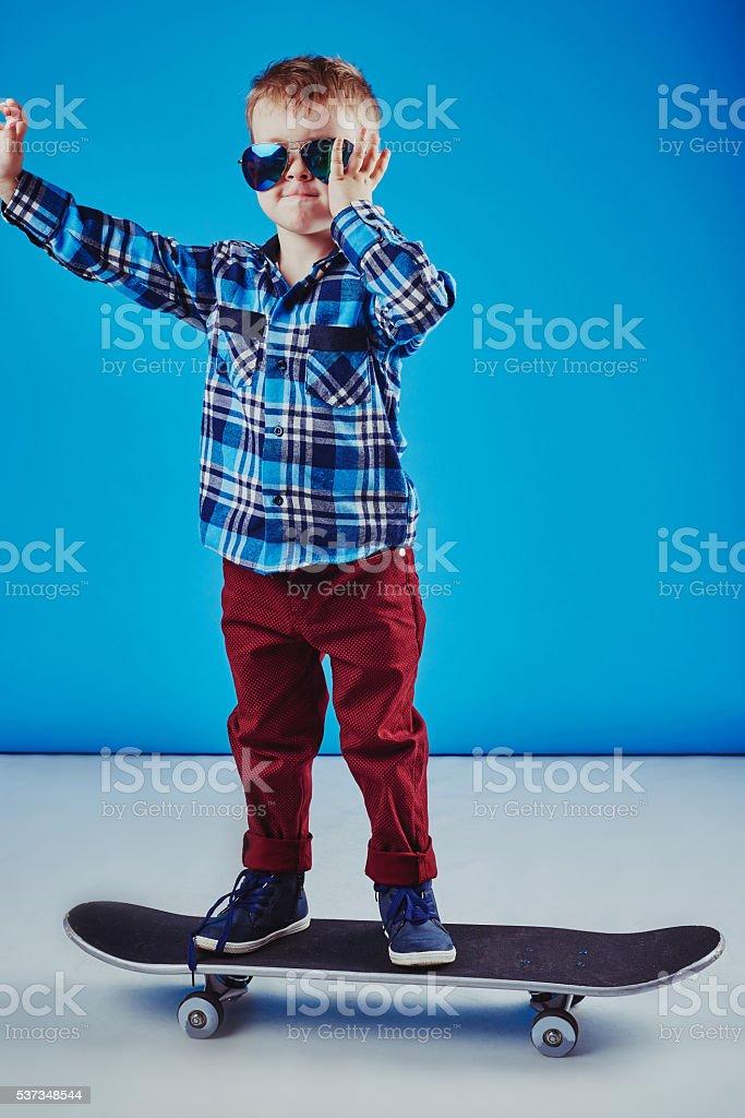 Happy boy riding skateboard