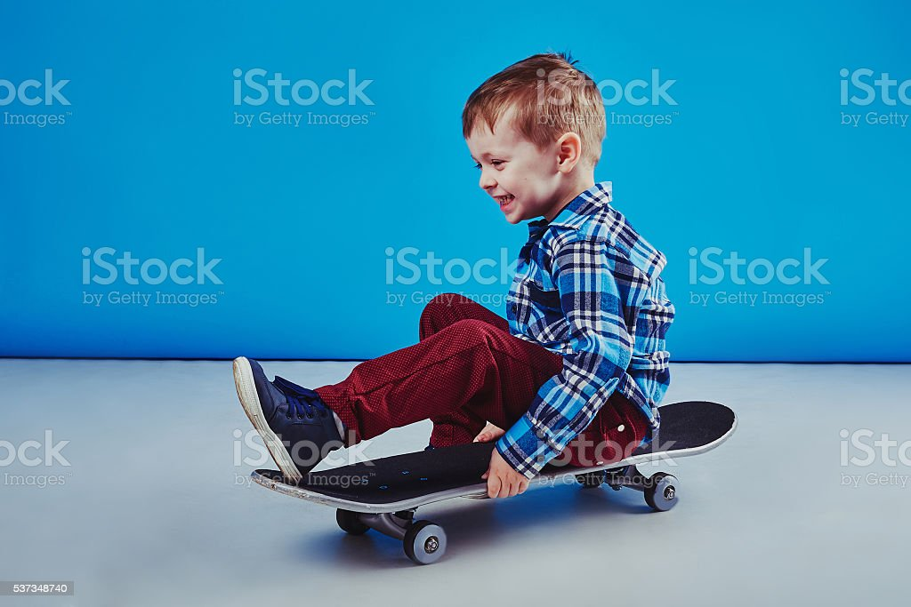 Happy boy riding skateboard