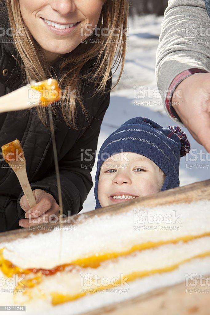 Happy boy wants to eat maple taffy stock photo