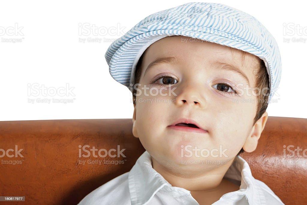 Happy boy wearing a flap cap stock photo