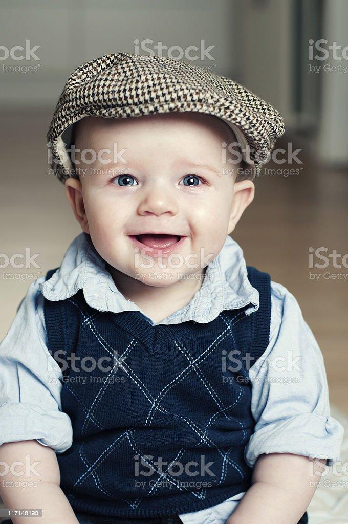 Happy boy wearing a flat cap royalty-free stock photo