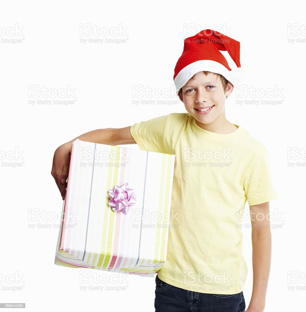 Happy boy wearing Santa hat as he holding a present royalty-free stock photo