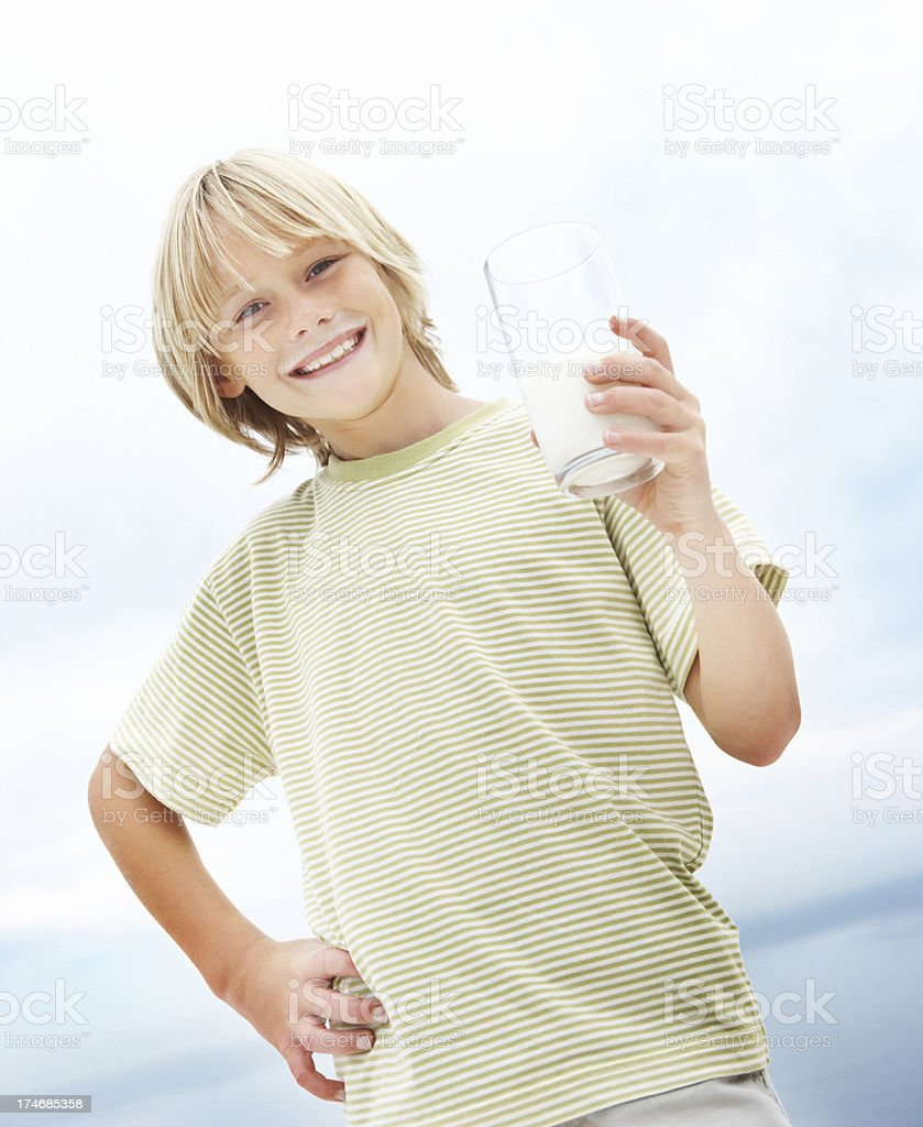 Happy boy with a glass of milk royalty-free stock photo