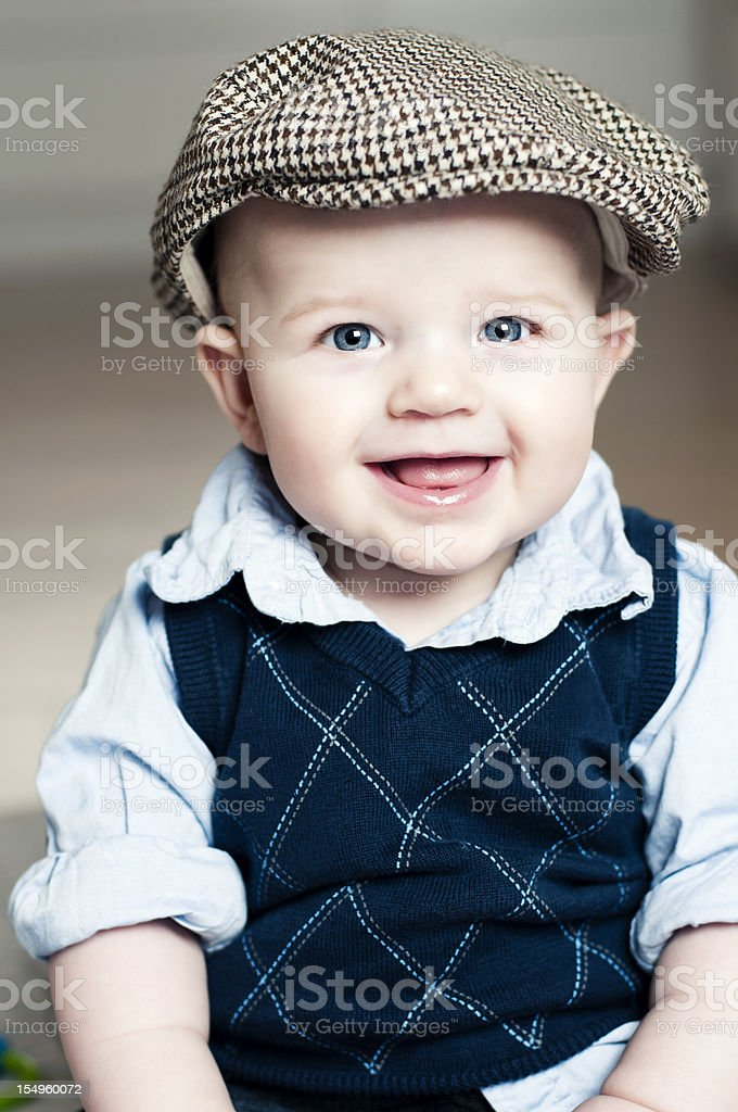 Happy boy with a great smile wearing a hat stock photo