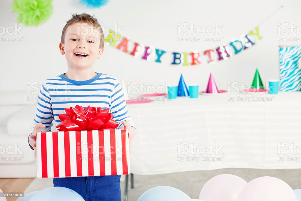 Happy boy with a present stock photo