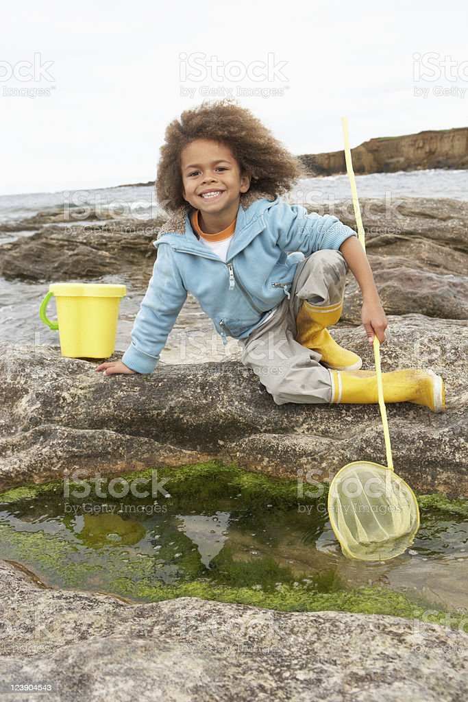 Happy boy with fishing net stock photo