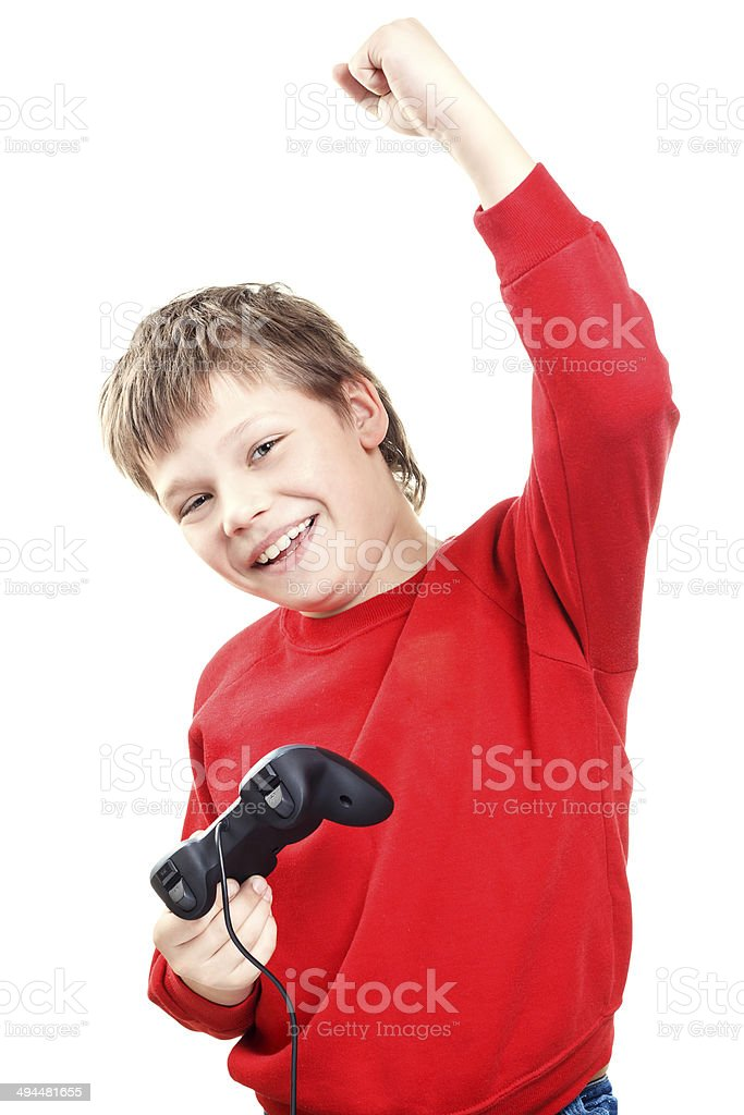 Happy boy with gamepad in hands royalty-free stock photo