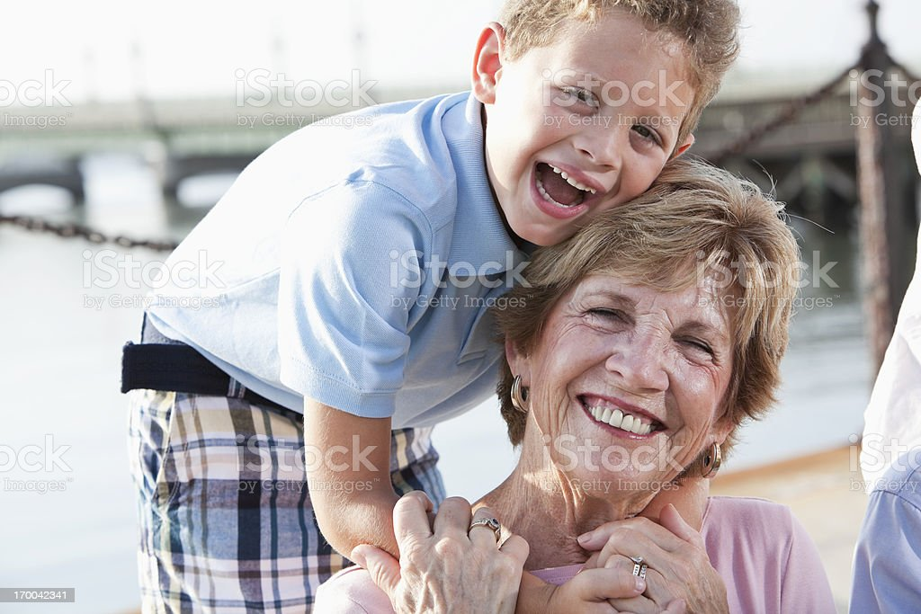 Happy boy with grandmother stock photo