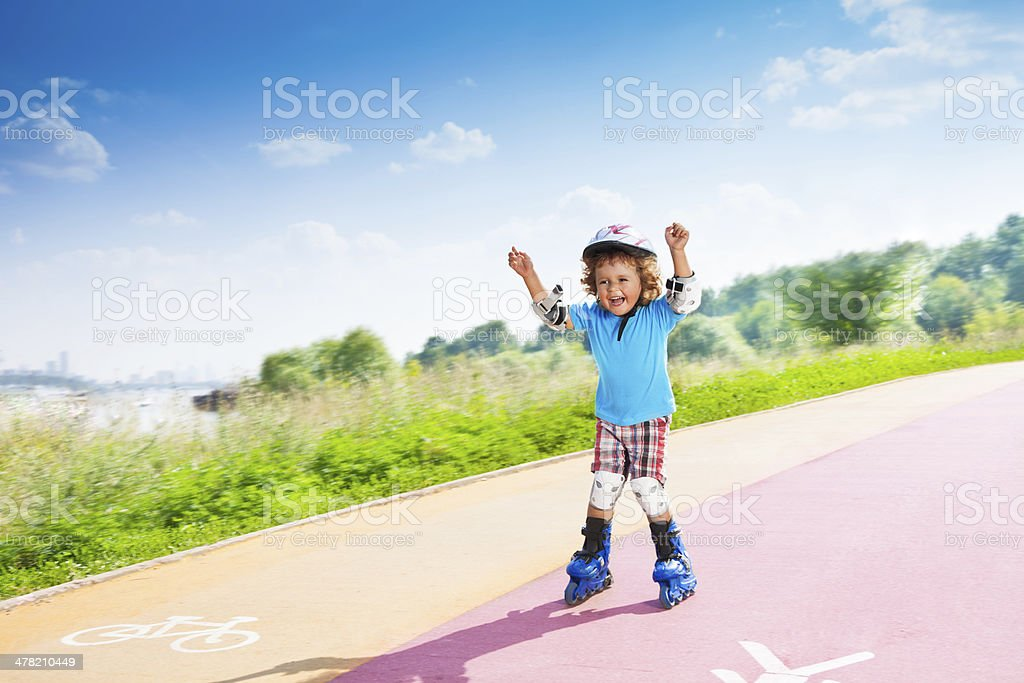 Happy boy with lifted hands stock photo