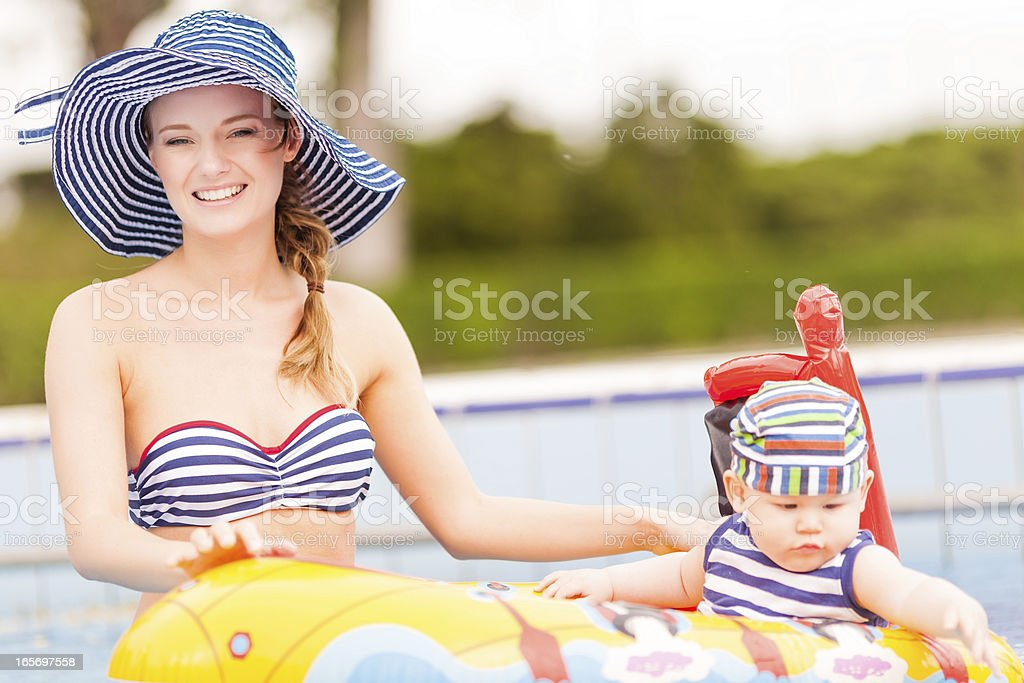 happy boy with mom in swimmingpool royalty-free stock photo