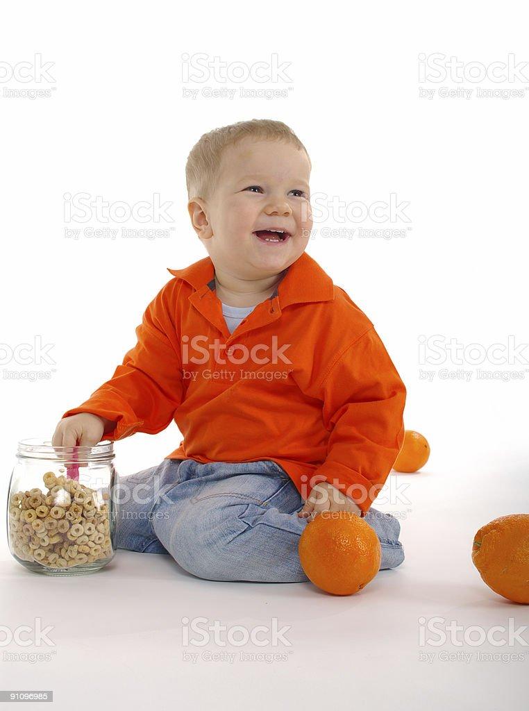 Happy boy with orange fruits royalty-free stock photo