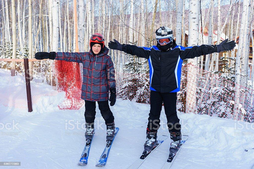 Happy boys ready to ski stock photo