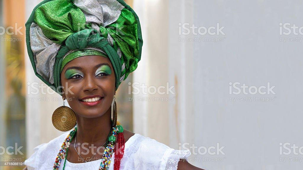 Happy Brazilian woman dressed in traditional Baiana attire stock photo