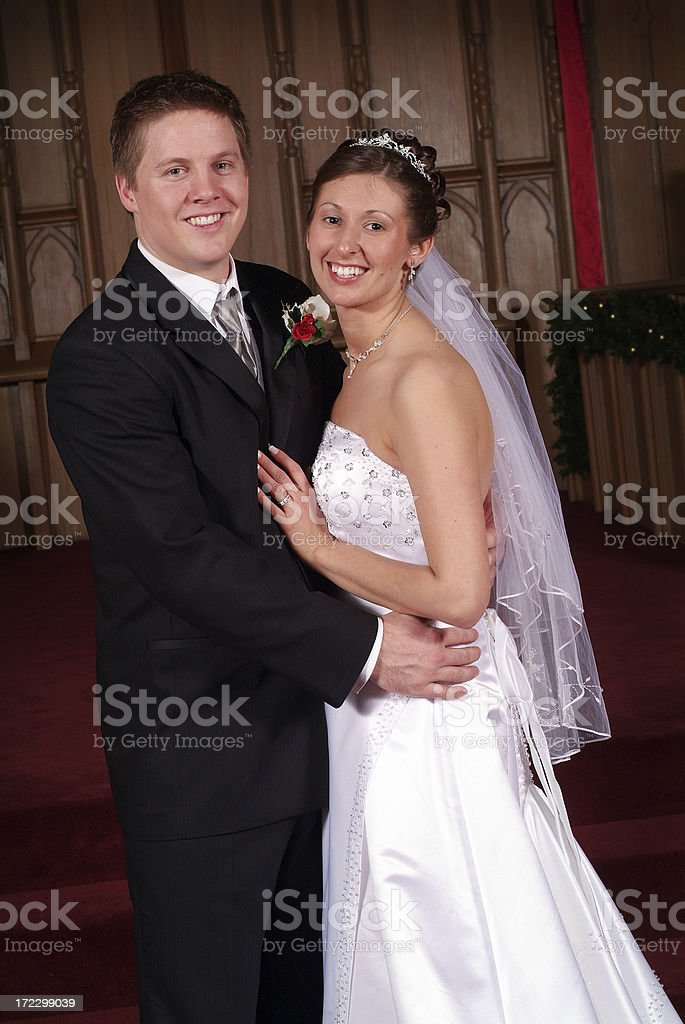 Happy Bride and Groom Hugging in the Church royalty-free stock photo