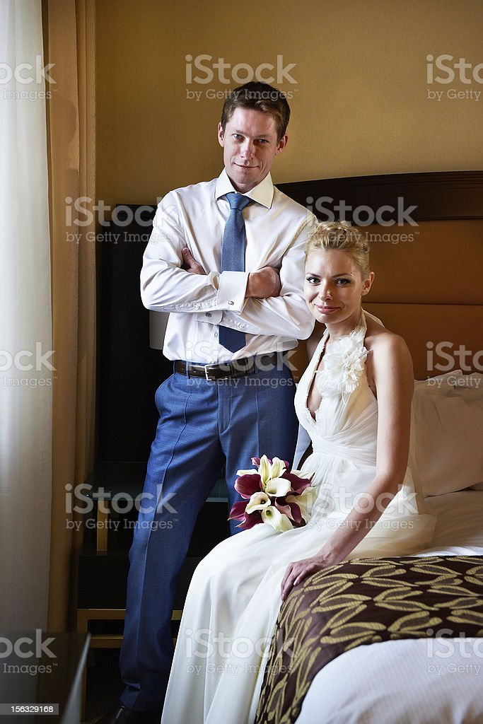 Happy bride and groom in bedroom royalty-free stock photo