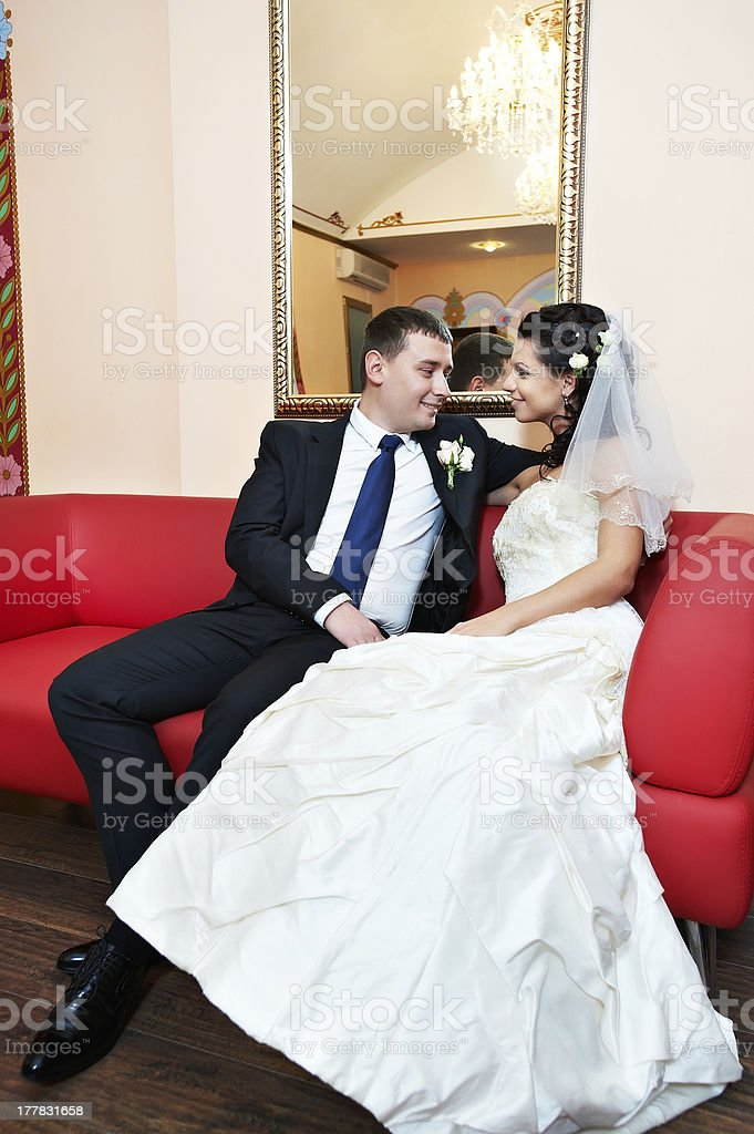 Happy bride and groom in luxury palace royalty-free stock photo