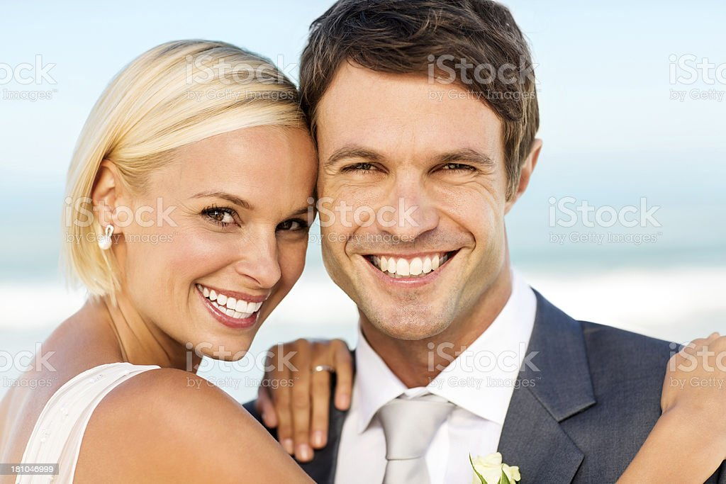 Happy Bride And Groom On Beach royalty-free stock photo