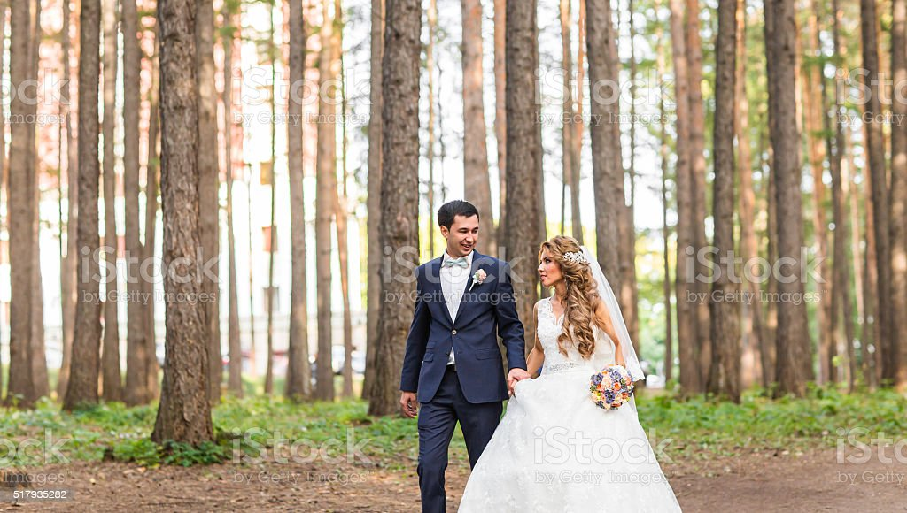 Happy bride and groom on their wedding day outdoors stock photo
