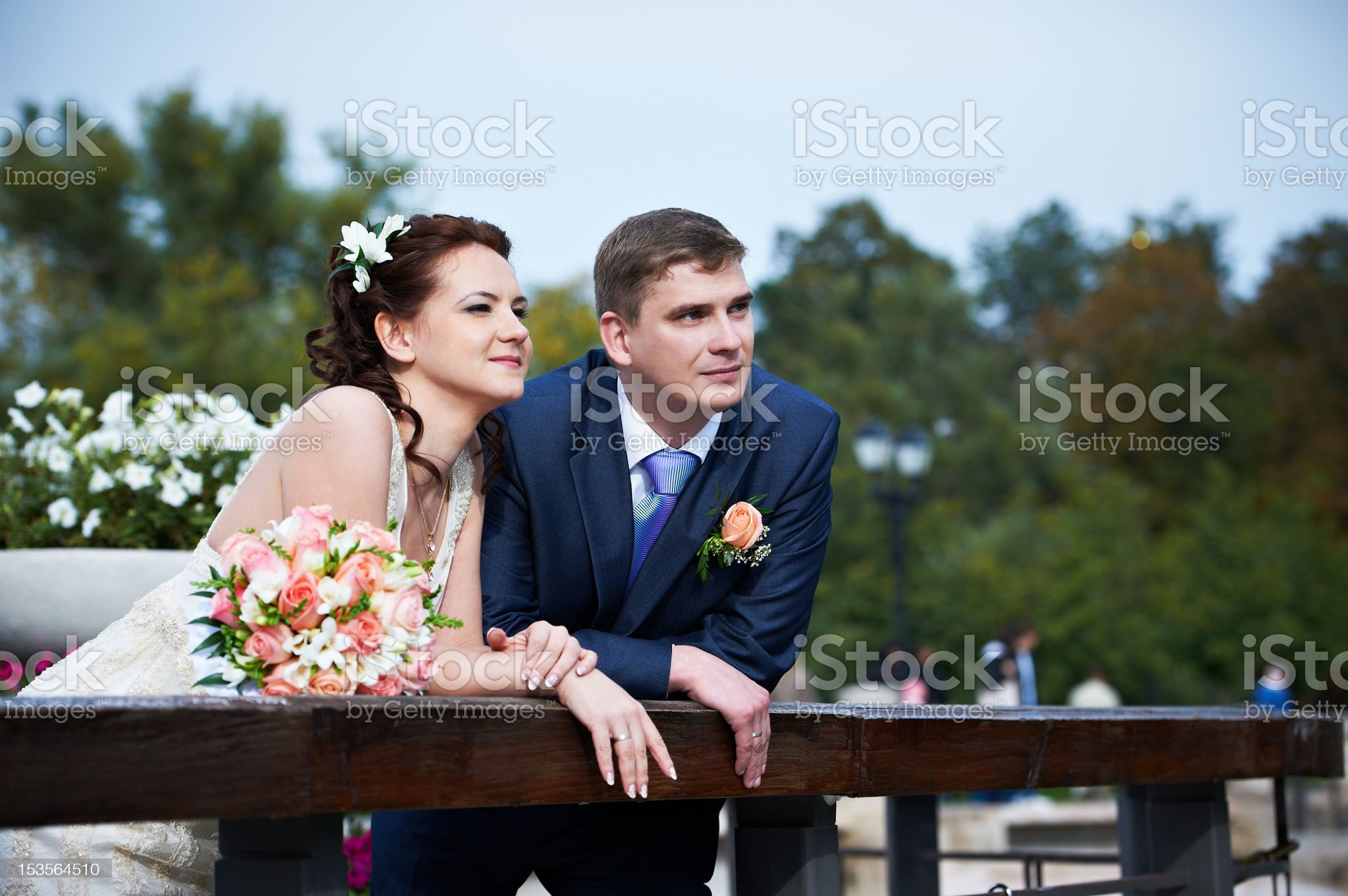 Happy bride and groom on wedding walk royalty-free stock photo