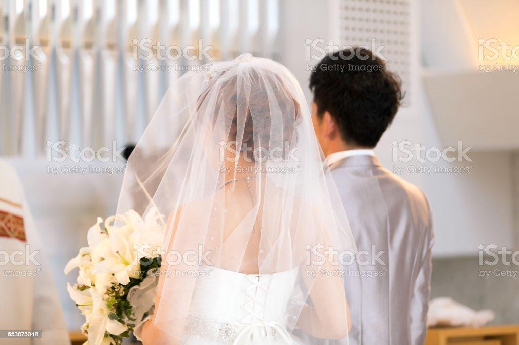 Happy bride and groom walking on virgin load stock photo