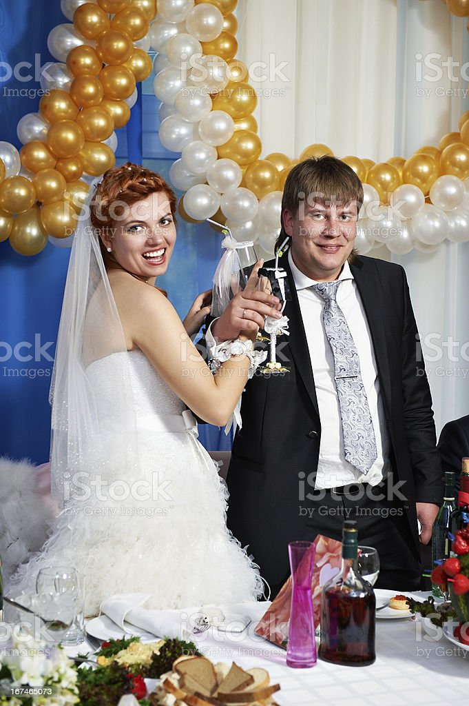 Happy bride and groom with champagne glasse royalty-free stock photo