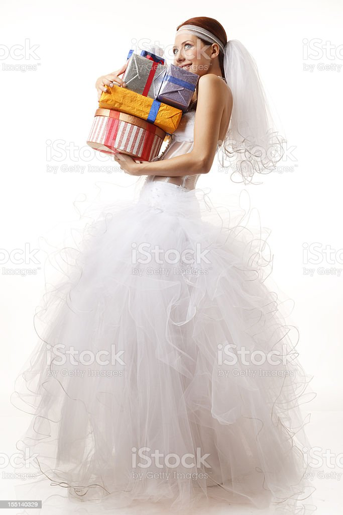 Happy bride holds hip of gifts royalty-free stock photo