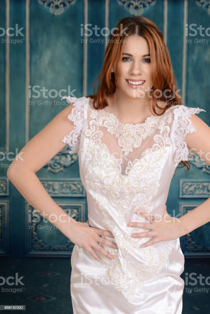 happy bride in lace dress stock photo