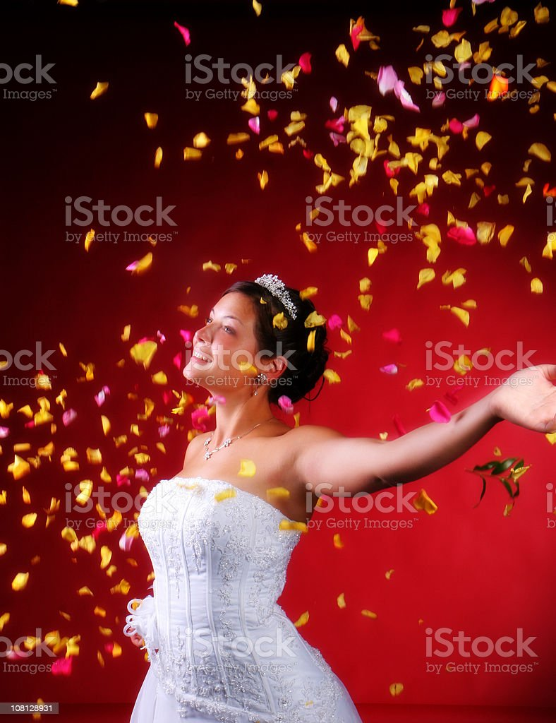 happy Bride in Rose petals royalty-free stock photo