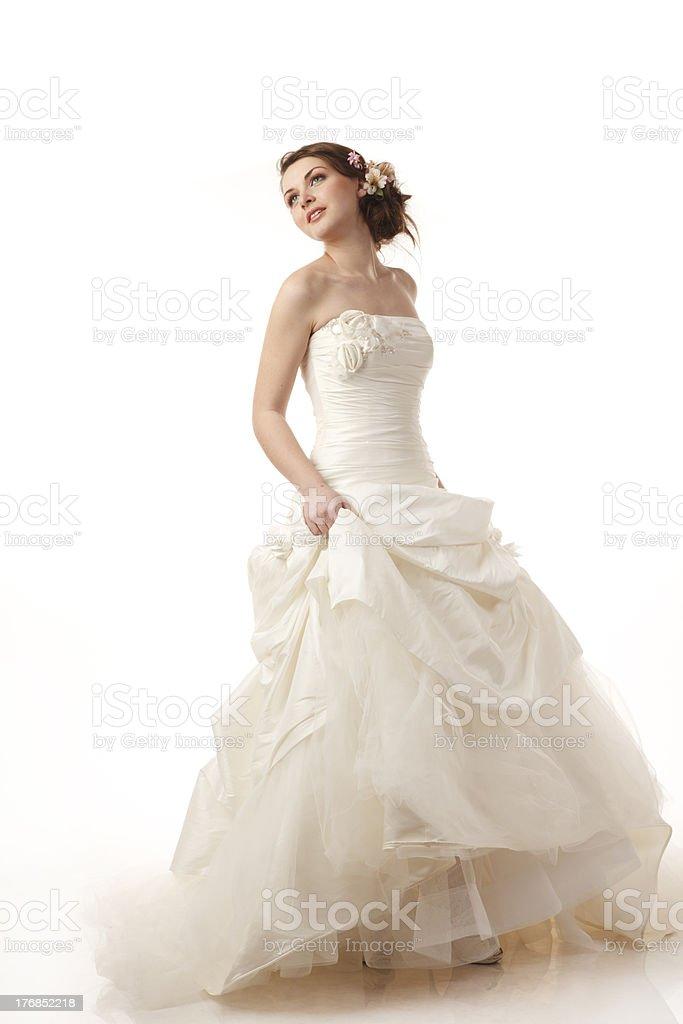 Happy bride is looking away stock photo