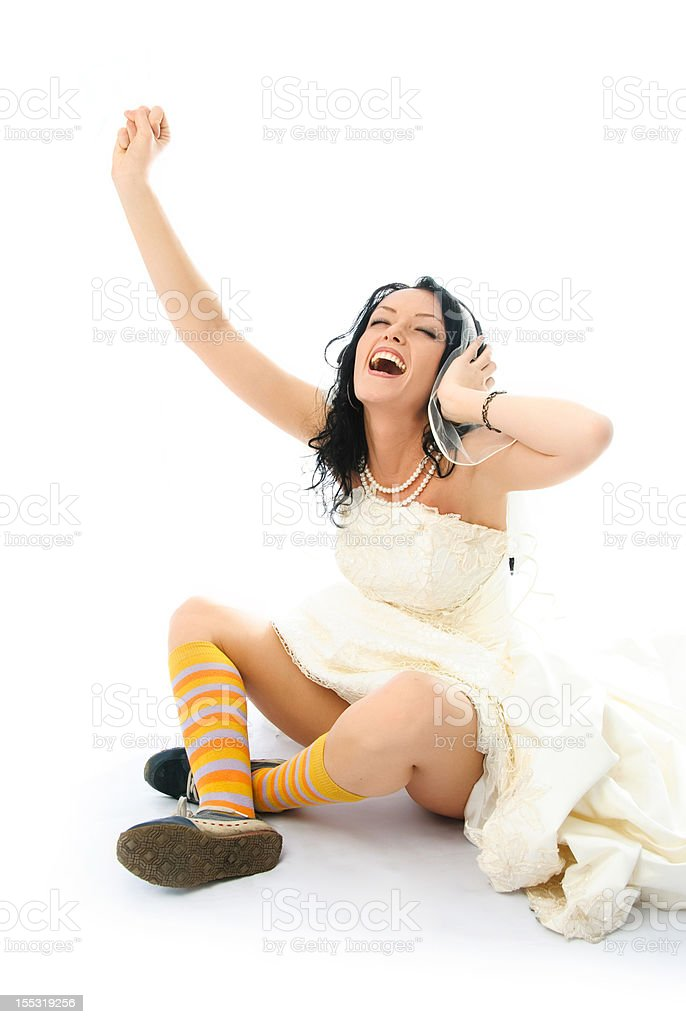 happy bride listening to the music stock photo