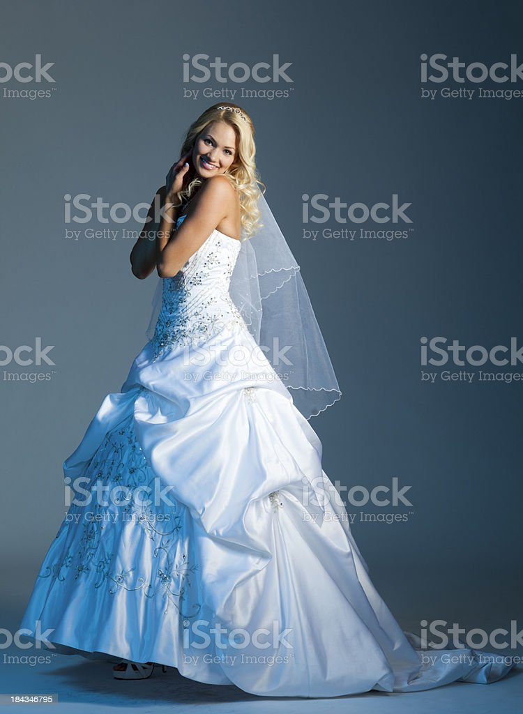 Happy bride on gray background royalty-free stock photo