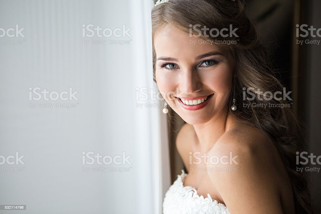 happy bride smiling at the camera stock photo