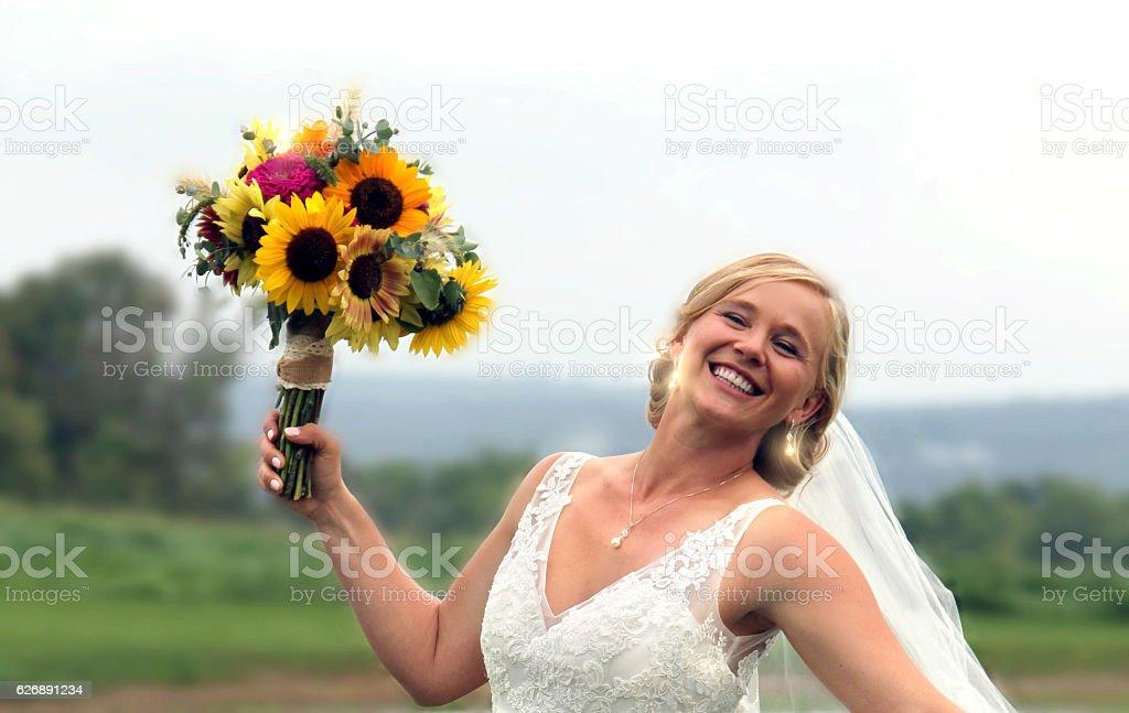 Happy Bride with sunflowers stock photo