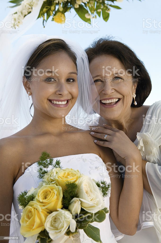 Happy Bridesmaid And Mother With Flower Bouquet stock photo