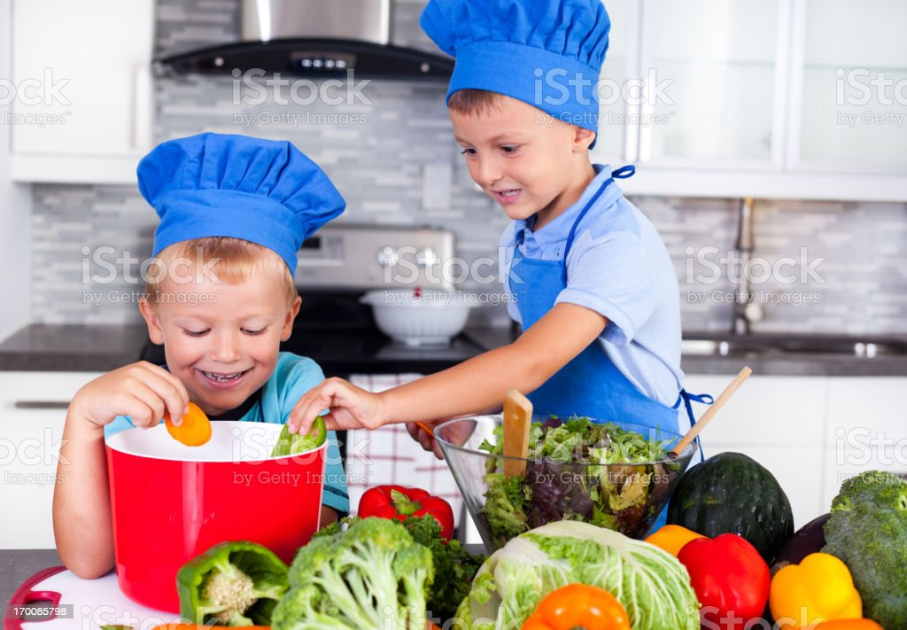 Happy brothers cooking together royalty-free stock photo