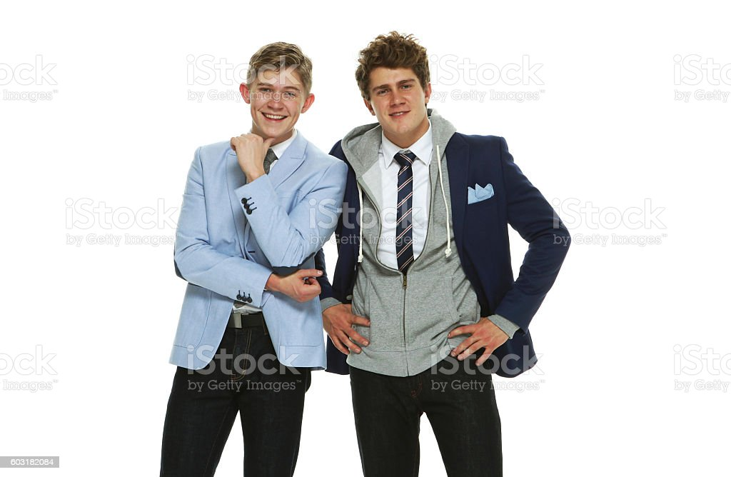 Happy brothers standing together stock photo