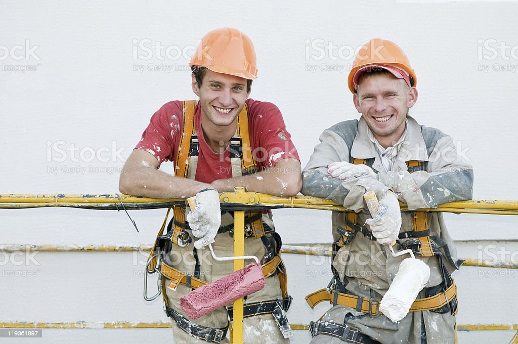 Happy builder facade painters stock photo