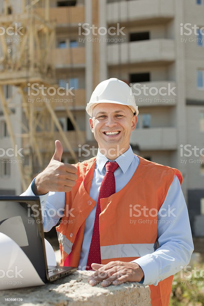 Happy builder in hardhat royalty-free stock photo