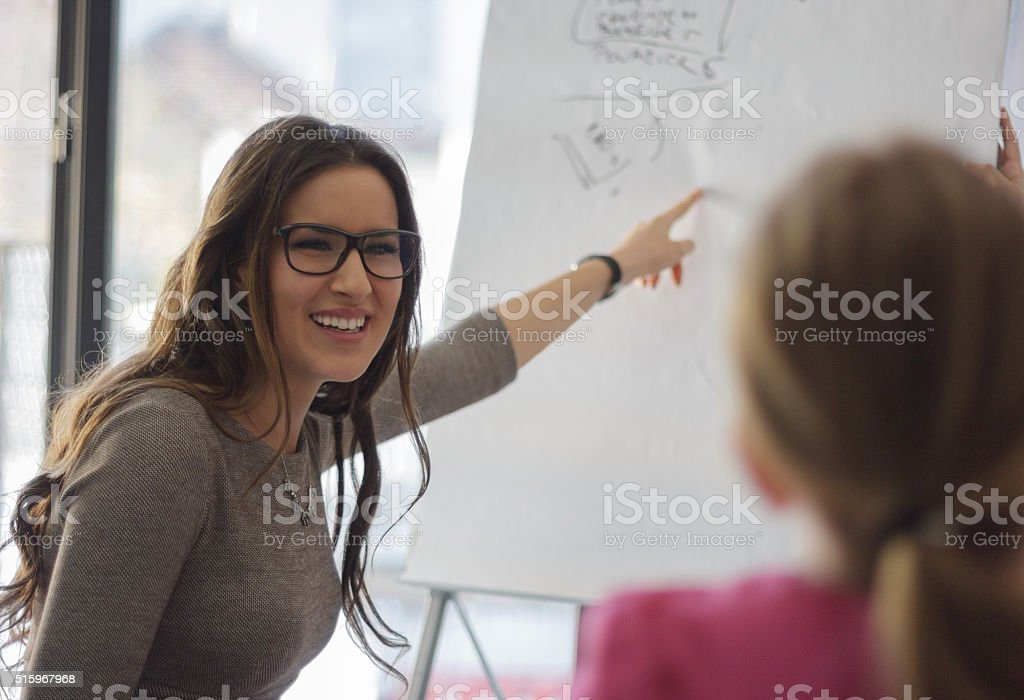Happy buisnesswoman at meeting stock photo