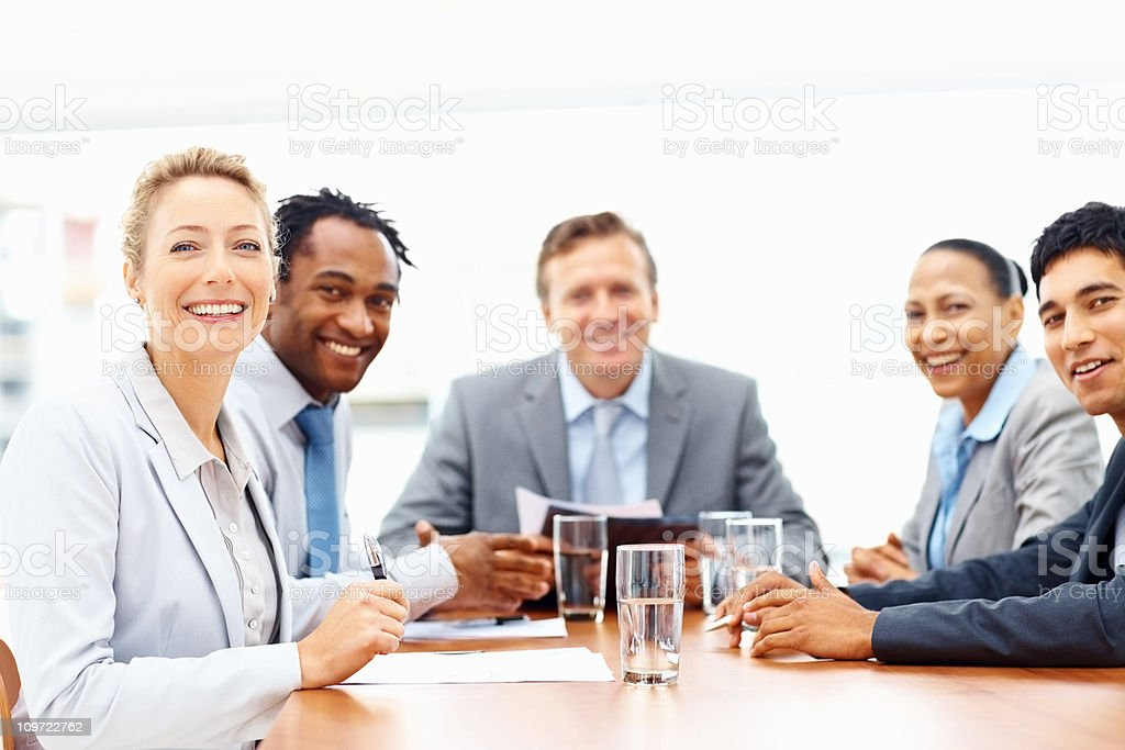 Happy business colleages at a meeting royalty-free stock photo