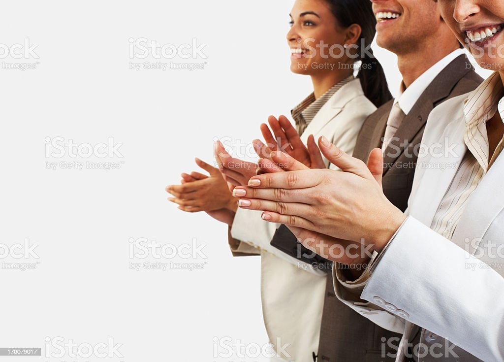 Happy business colleagues clapping hands royalty-free stock photo
