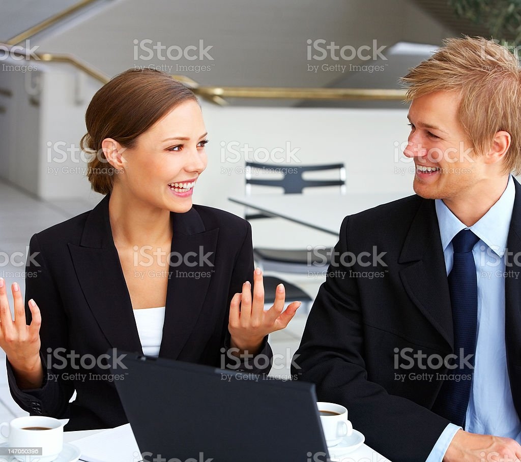 Happy business colleagues discussing in the office royalty-free stock photo